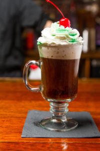 Irish Coffee with whipped cream and a cherry
