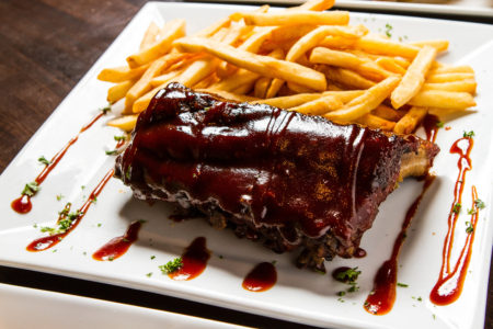 1/2 Rack Smoked Baby Back Ribs served with french fries