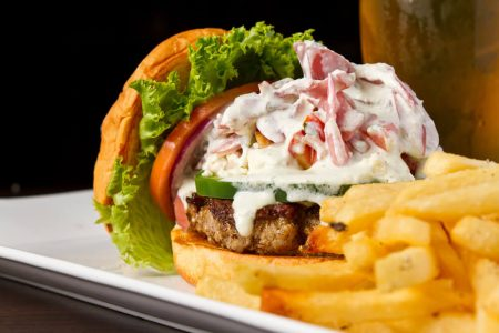 Burger plated with french fries