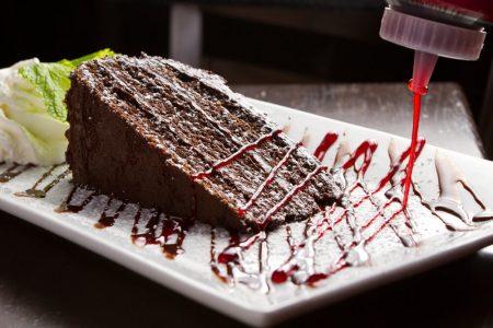 Raspberry drizzle on fudge cake