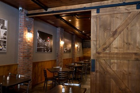 Barn door leading to dining tables