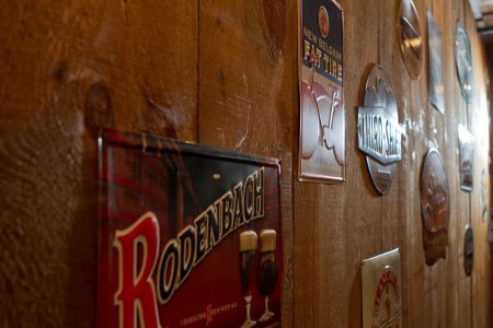 "Signs on wall for beer ""Rodenbach"" ""New Belgum"""