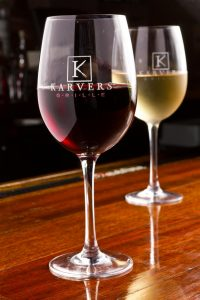Two Karvers wine glasses, one with red wine and one with white wine