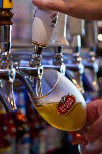 Pouring Stella Artois from tap
