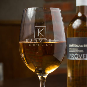 Photo of our wine glass with the Karvers logo on it